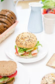 A fresh deli sandwich on the dinner table — Stock Photo