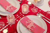 Christmas table setting in red and white — Stock Photo