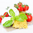 Pasta, tomatoes, basil — Stock Photo