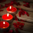 Valentines candles on wooden background — Stock Photo