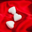 Valentines white hearts isolated on red — Stock Photo #28777085