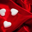 Valentines white hearts isolated on red — Stock Photo #28778665