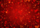 Red Valentine's day background with hearts — Stock Photo
