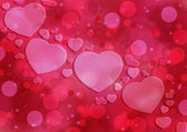 Abstract romantic background with hearts — Stock Photo
