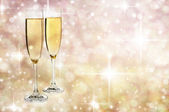 Two Glasses of champagne against golden background — Stock Photo