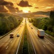 Stock Photo: Highway traffic in sunset