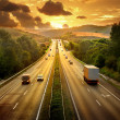 Highway traffic in sunset — Stock Photo