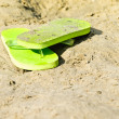 Flip-flop on the beach — Stok fotoğraf