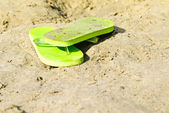 Flip-flop on the beach — Stock Photo