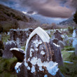 Spooky Halloween graveyard with dark clouds — Stock Photo