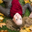 Foto Stock: Young woman with autumn leaves