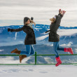 Winter vacation, friends jumping  — Stock Photo