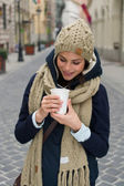 Fashionable woman holding coffee outdoors — Foto de Stock