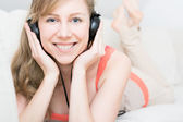 Young beautiful woman enjoying the music at home — Stok fotoğraf
