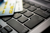 Concept of online shopping with keyboard and credit card — Stock Photo