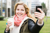 Selfie - self portrait with mobile phone — Stock Photo