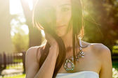Young woman enjoys sun beams — Stock Photo