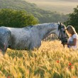 Beautiful girl and horse outdoors — Stock Photo #48126405