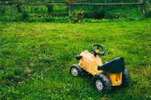 Abandoned yellow toy car — Stock Photo