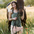 Brunette woman kissing beautiful horse — Stock Photo