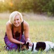 Portrait of a woman with her beautiful dog lying outdoors — Stock Photo