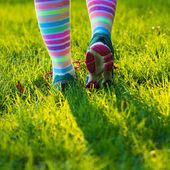 Running shoes and colorful socks — Stock Photo