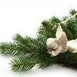 Pine branches with Christmas ornaments on white — Стоковая фотография