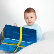 Child. little baby boy with gift — Stock Photo