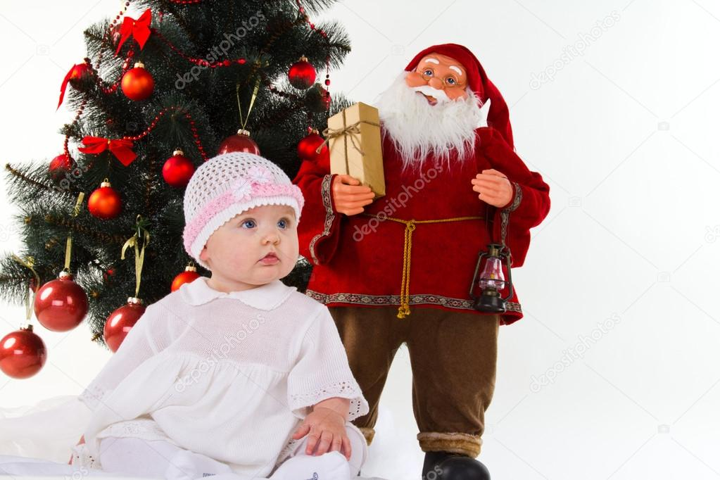 Little baby girl with christmas decoration isolated on white — Stock Photo #14758491