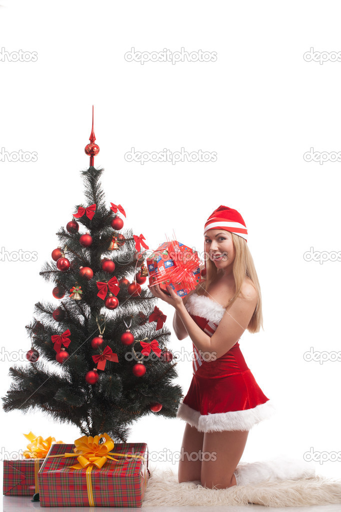 Young happy woman near a Christmas tree. Isolated over white background  Stock Photo #15559295