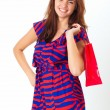 Beautiful casual young woman with shopping bags — Stock Photo