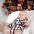 Stock Photo: Little baby lying at home in christmas interior