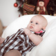 Little baby lying at home in christmas interior — Stock Photo #19077725