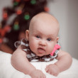 Portrait of little baby on background with christmas tree — Stock Photo