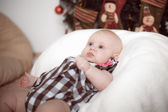 Little baby lying at home in christmas interior — Stock Photo