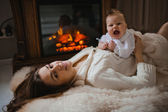 Young mother holding her newborn baby — Stock Photo