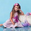 Stock Photo: Cute little girl on blue background