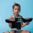 Little girl wearing big mothers shoes — Stock Photo #22264161