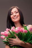 Portrait of brunette woman with tulips — Stock Photo