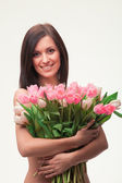 Portrait of brunette woman with tulips — Stok fotoğraf