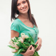 Brunette woman with tulips — Stock Photo