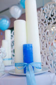 Blue and white candles tied with a ribbon on the table — Stock Photo