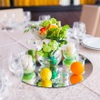 Tables decorated with flowers and candles — Stock Photo