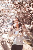 Pregnant woman in the flowering branches — Stock Photo