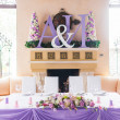Bride and groom's table decorated with flowers — Stock Photo #33364897