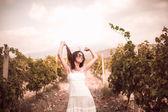 Woman posing in a vineyard — Stock Photo