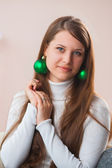 Girl with Christmas toys — Stockfoto