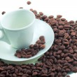 Cup on coffee beans — Stock Photo