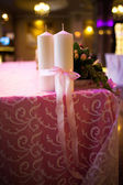 Candles tied with a pink ribbon — Stock Photo