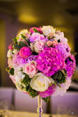 Celebratory tables decorated with flowers — Stock Photo